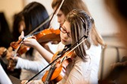 Violin students performing